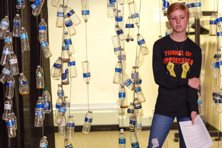 Student stands at Tunnel of Oppression