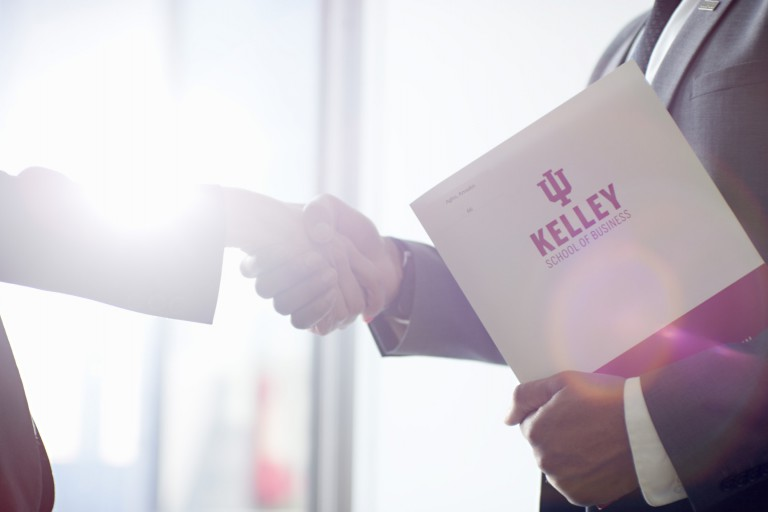 Kelley people shake hands