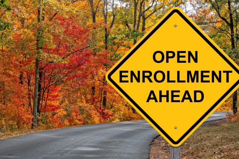 A road sign reading 'open enrollment ahead'