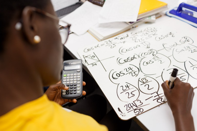 Ayo Betiku shows her work on a math problem.