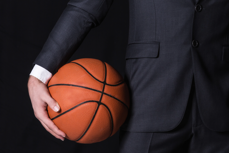 Business man holding basketball