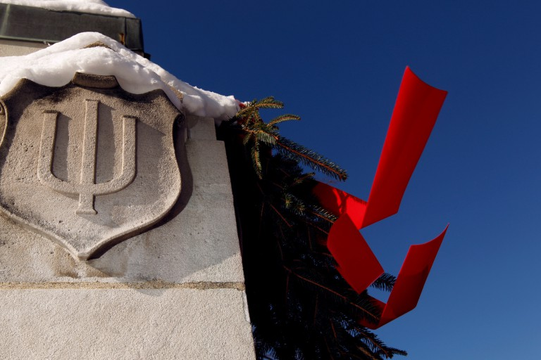 IU logo on a building decorated with a red bow
