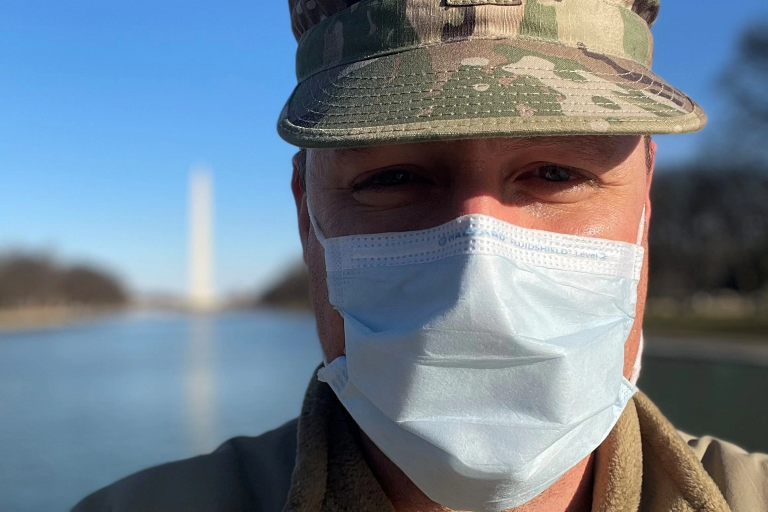 Dr. Stephen Sample wears a mask with the Washington Monument behind him