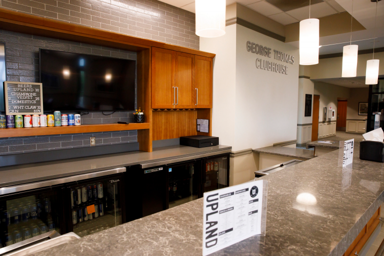 The bar of the Upland restaurant inside the George L. Thomas Clubhouse