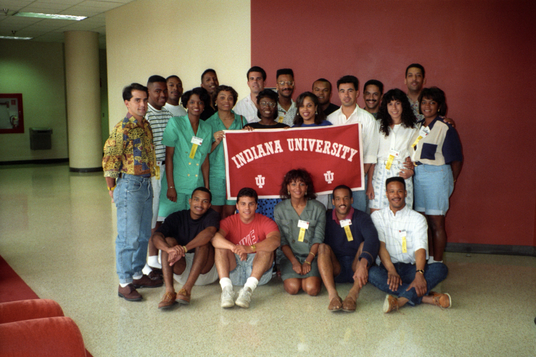 Students holding an IU banner