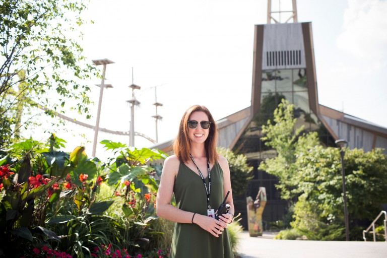 Alli Donovan stands in front of plants at a zoo.