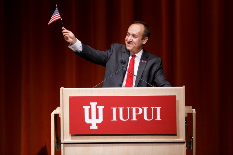 IUPUI chancellor waves U.S. flag he received in 1992