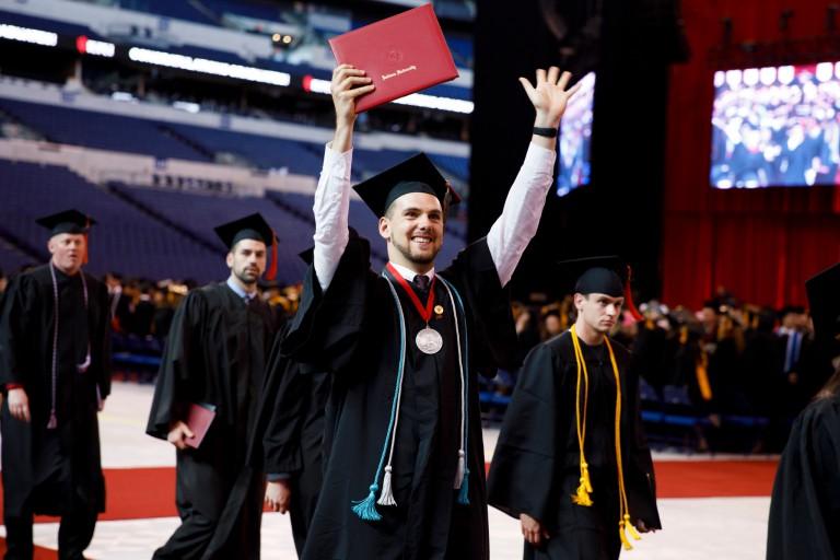 A graduate celebrates