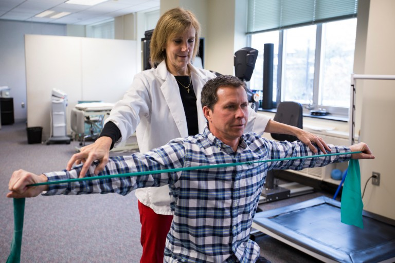 A physical therapist works with a patient at IU Health Center