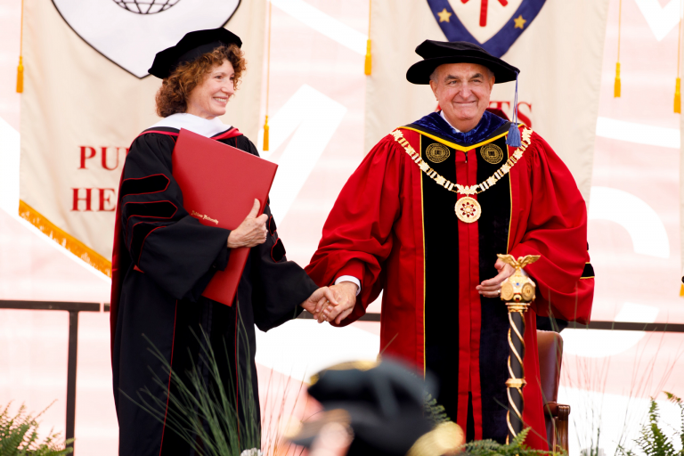 Michael McRobbie and Laurie Burns McRobbie on stage after receiving honorary IU degrees