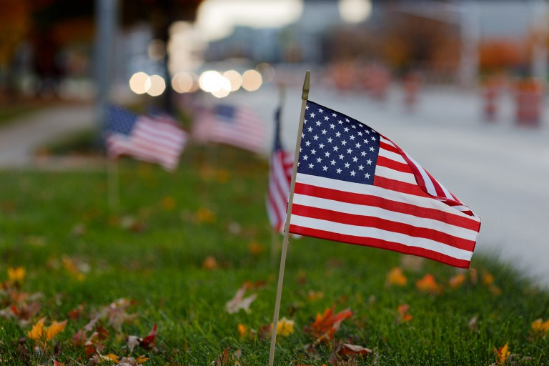 American flags planted in lawn