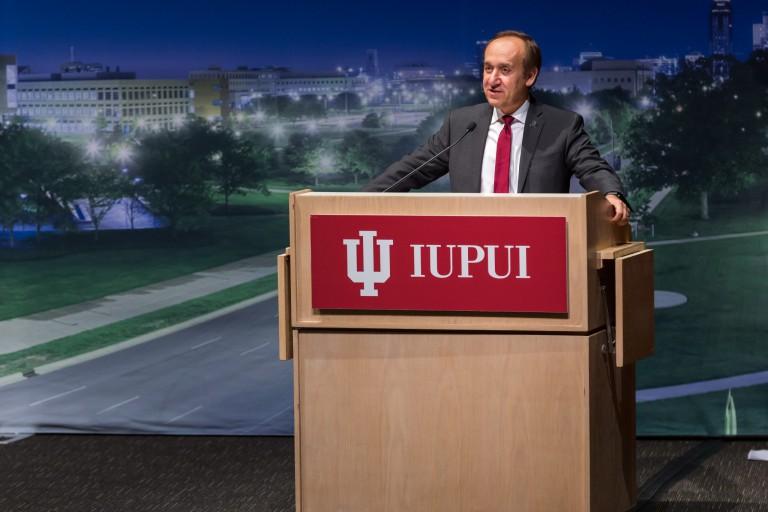 Chancellor Nasser H. Paydar stands behind a podium