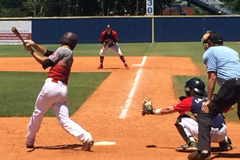 Batter swings at youth baseball tournament at Middle Tennessee State University.