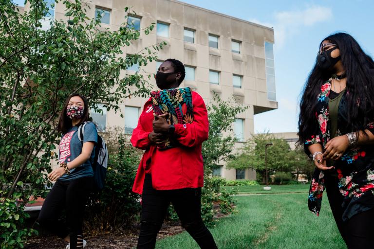 Ashley Nguyen, Mariam Sylla and Liza Matthew walk on campus