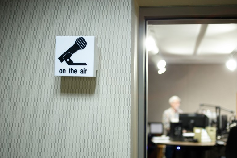 A sign outside a radio studio reading 'on the air'