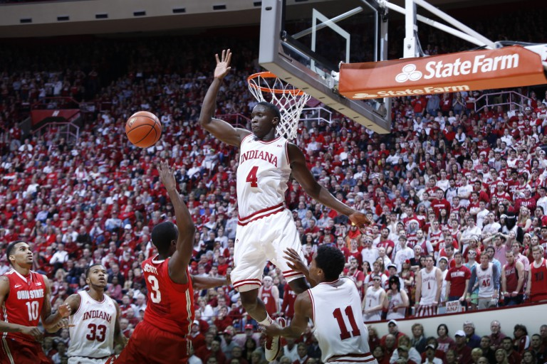 VIctor Oladipo jumps to block another player's shot.