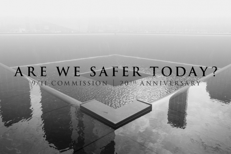 'Are We Safer Today' text over World Trade Center memorial