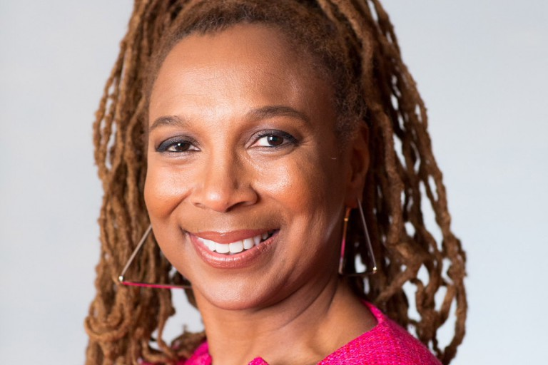 Kimberle Crenshaw smiles for a photo.