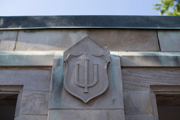 Limestone IU trident on a building