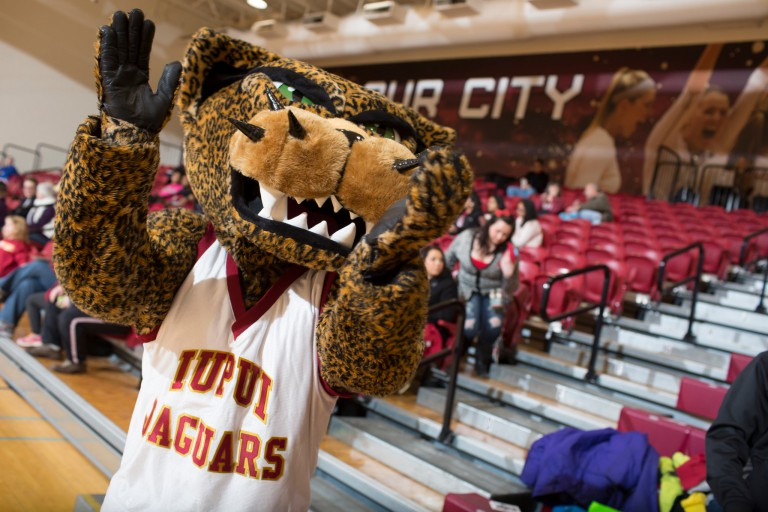 Jawz, the IUPUI mascot, pumps up a basketball crowd.