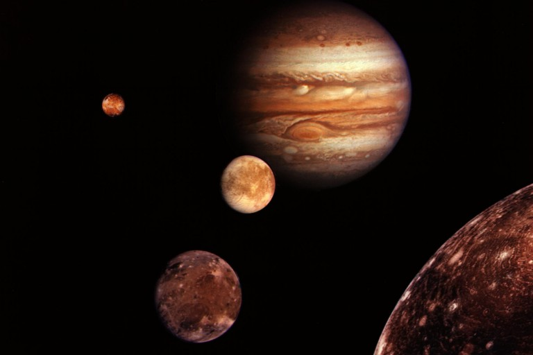Jupiter and four of its moons