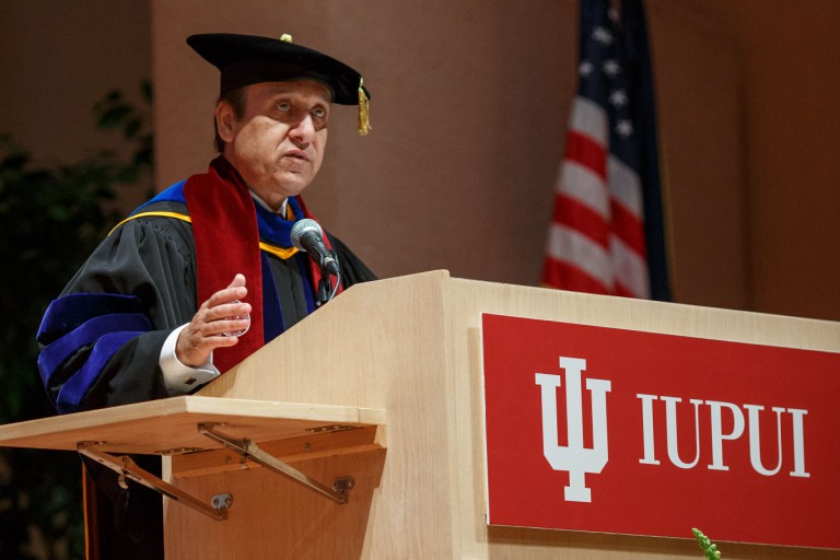 IUPUI Chancellor Nasser Paydar speaks at a podium