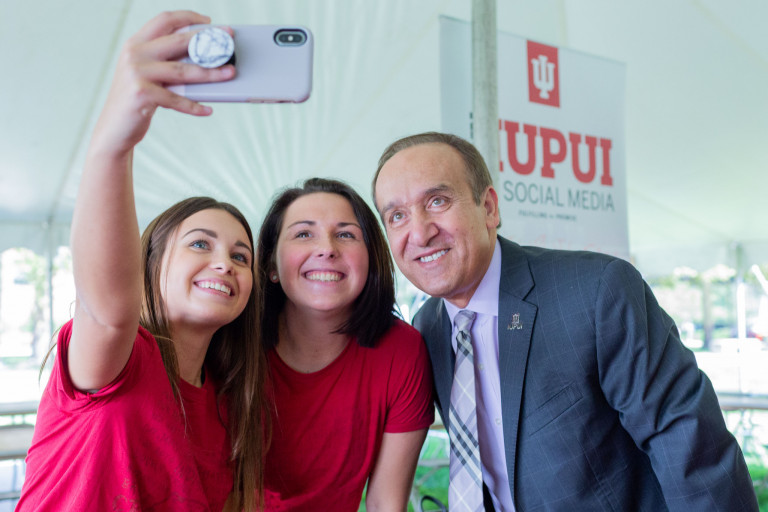 IUPUI Chancellor Paydar takes a selfie with IU Studios social media interns
