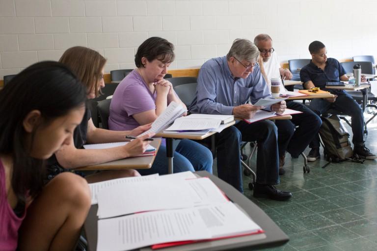 People workshop stories together