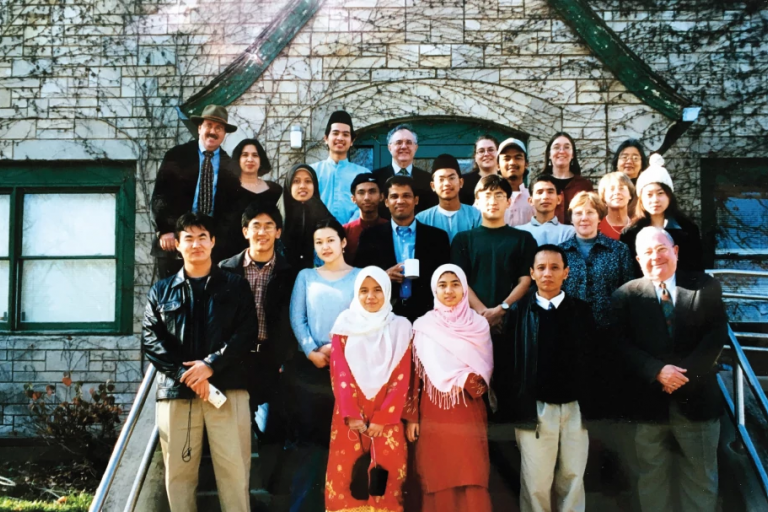 IU administrators with Malaysian students in the late '80s