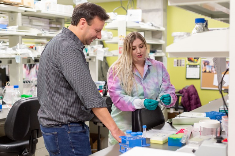 Professor Jason Meyer speaks with student Clarisse Filgor.