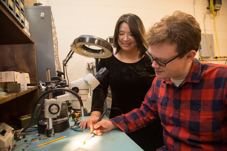Nathan Callahan and Chen-Yu Liu work on a silicon photo multiplier