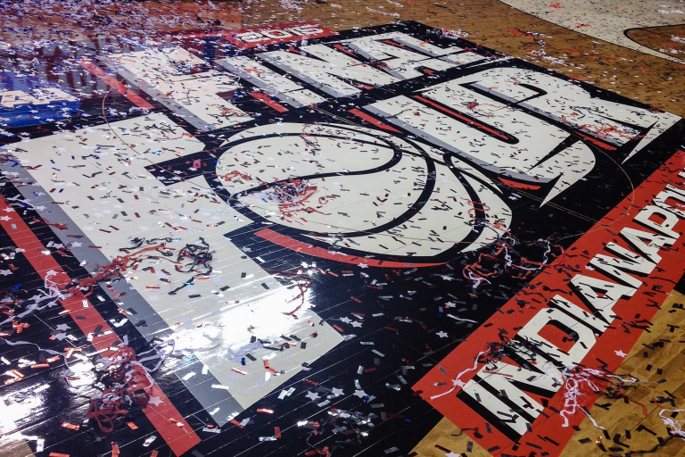 basketball floor with a Final Four decal covered in confetti