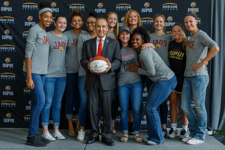 IUPUI Chancellor Nasser Paydar and the Jaguars women's basketball team
