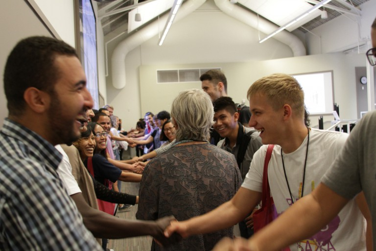 Fulbright Foreign Students shake hands in a networking exercise