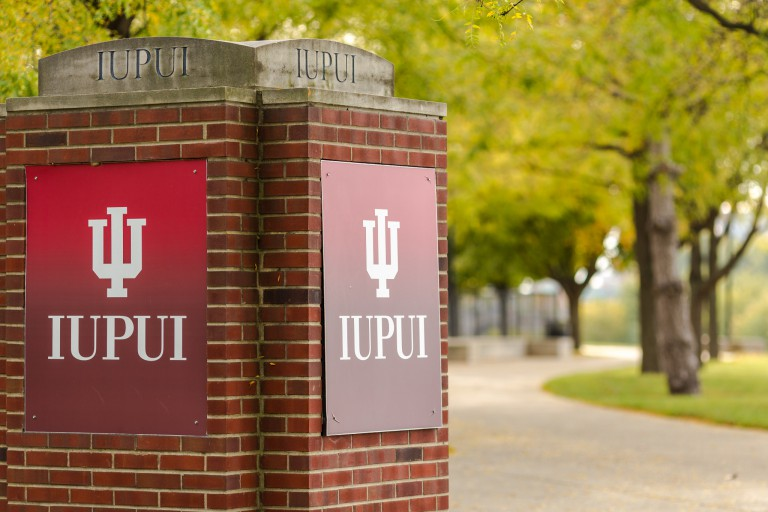 IUPUI sign on short brick pillar on campus