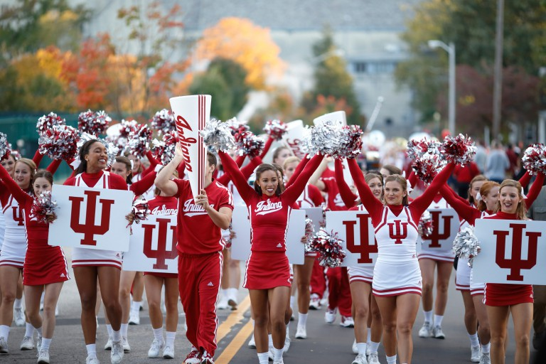 IU Cheerleaders march in the 2016 homecoming parade.