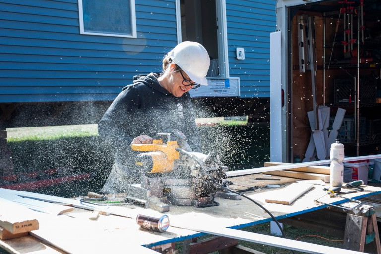 A woman volunteers at a Habitat for Humanity build.