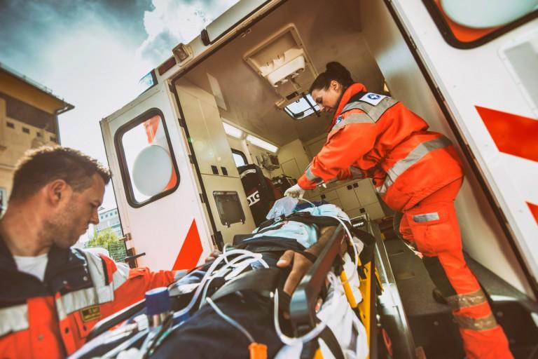 Paramedics transport a patient on a stretcher