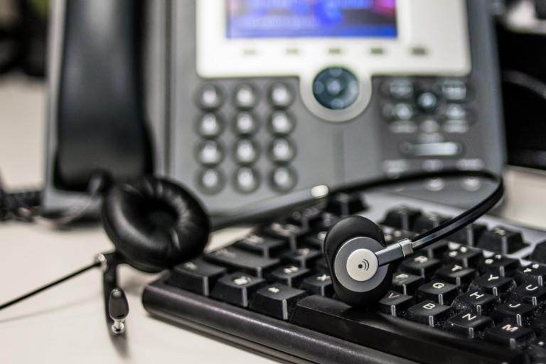 A telephone, headset and keyboard.