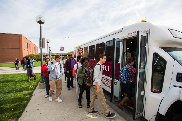 Students at IUPUI boarding a Campus Commute bus.