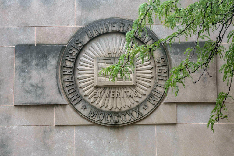 Limestone seal of IU on building