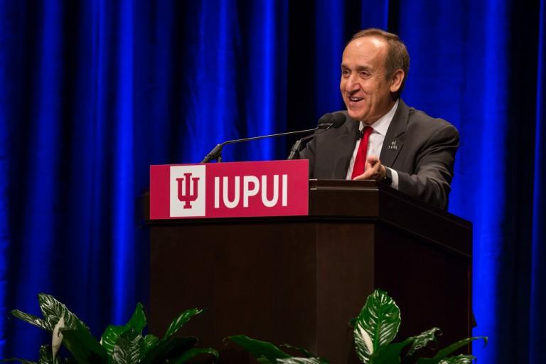 Nasser Paydar speaking at a podium