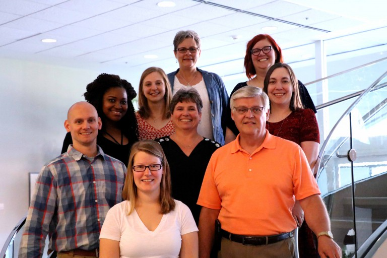 The Health and Life Sciences Advising Center staff poses on some stairs.
