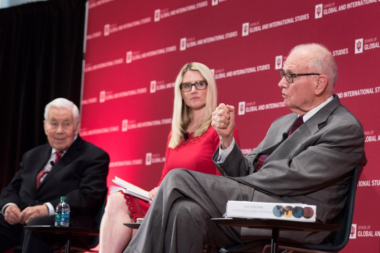 Richard Lugar, Marie Harf and Lee Hamilton, from left, sit on stage