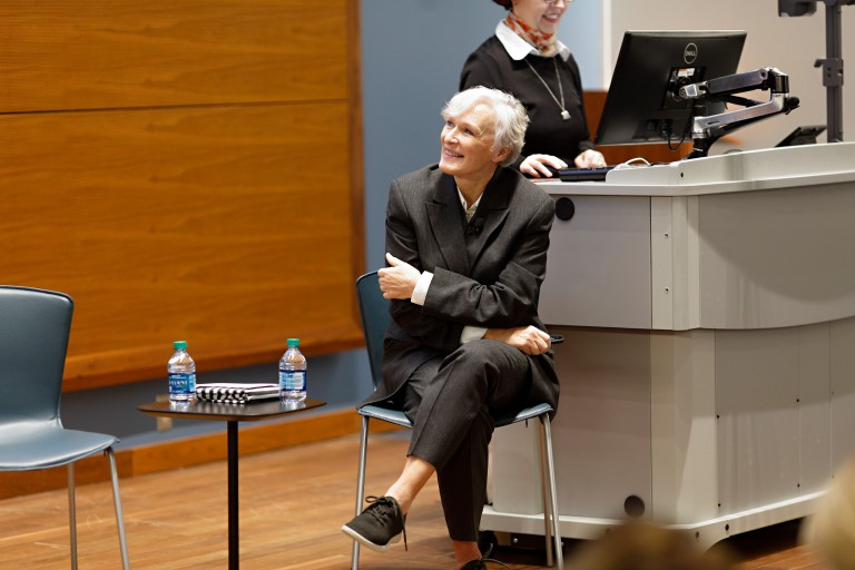 Glenn Close sitting in lecture hall