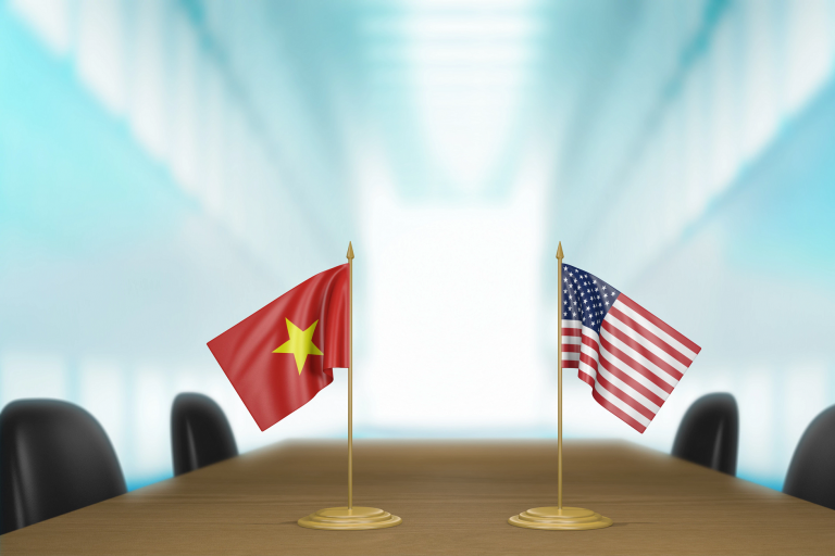 The American and Vietnam flags on a table