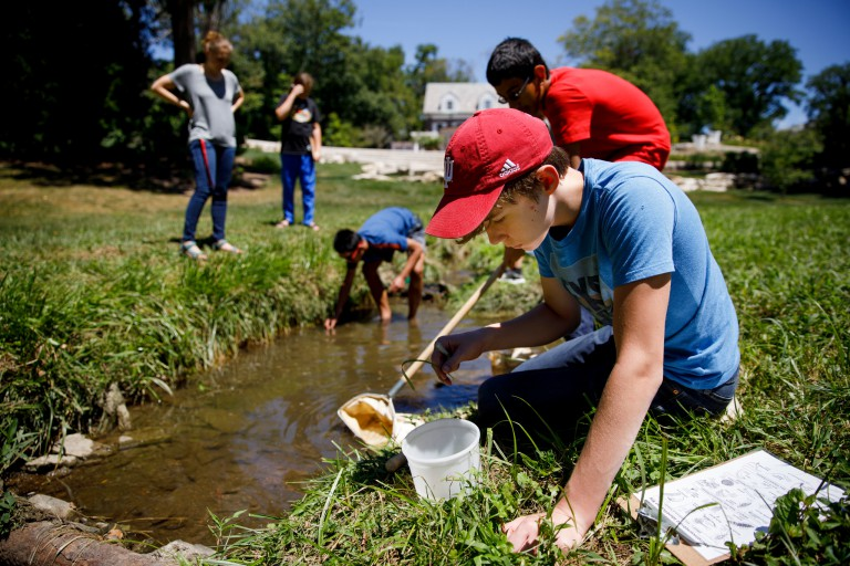 Students gather specimens from Jordan River