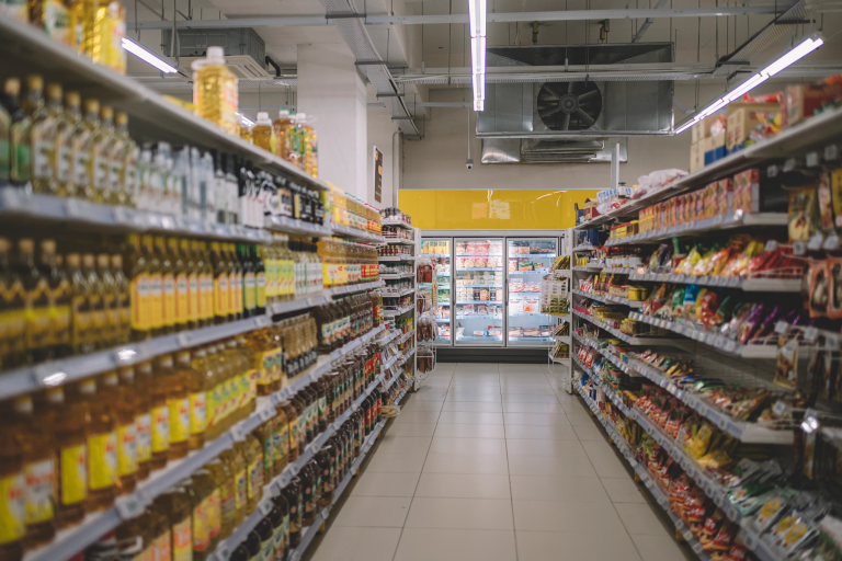 Grocery store shelves lined with products