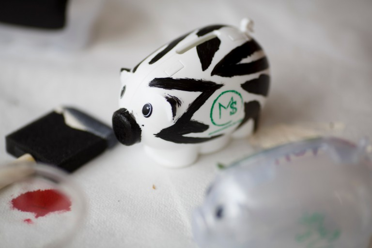 Piggy bank with an 'm' painted on the side.
