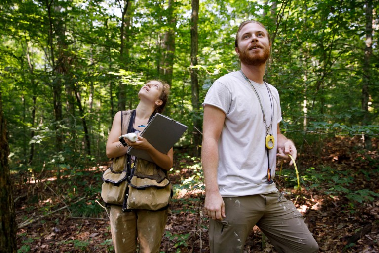 IU forest ecology technicians Aubree Keurajian and Matthias Gaffney in Lilly-Dickey Woods